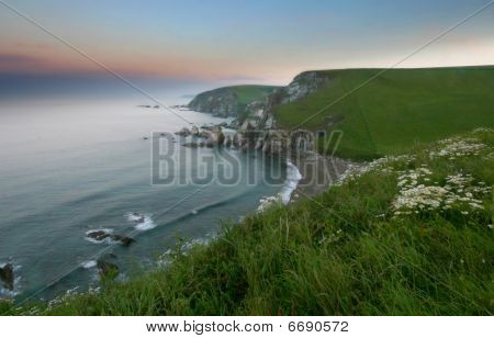 A Dawn Sea Mist Rolls In Towards The Shore At Westcombe South Hams Devon