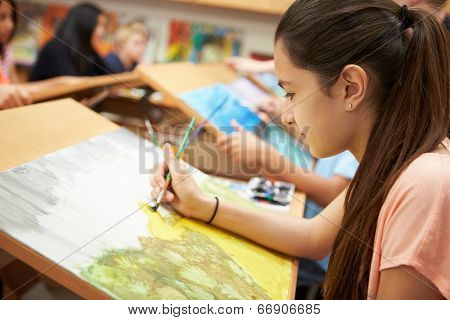 Female Pupil In High School Art Class
