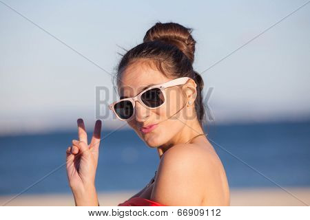 woman on vacation blowing kiss