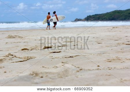 Soft focus background, Surfers Walking on beach