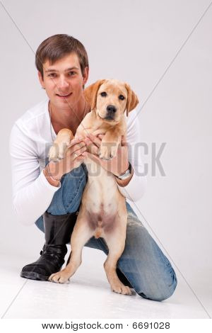 Handsome Man With Labrador Retriever