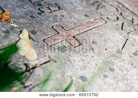 Christian Grave Marker In Cemetery