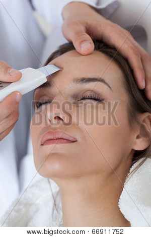 Woman Receiving Facial Rejuvenating Treatments