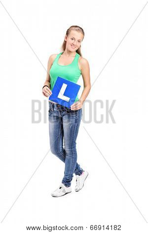 Full length portrait of a young girl holding an l sign isolated on white background