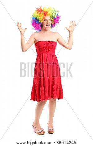 Full length portrait of a woman wearing a wig and gesturing with hands isolated on white background