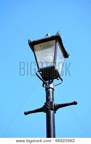 Old iron streetlight.