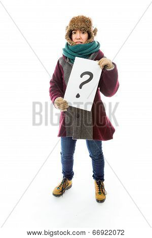 Young woman in warm clothing and showing question mark on white