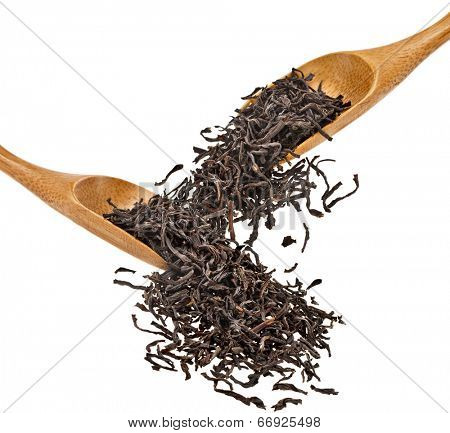 Tea leaves and wooden spoon set  isolated on white background