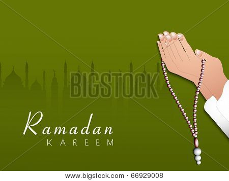 Praying hands with praying manis on mosque silhouetted green background for holy month of Muslim community Ramadan Kareem.