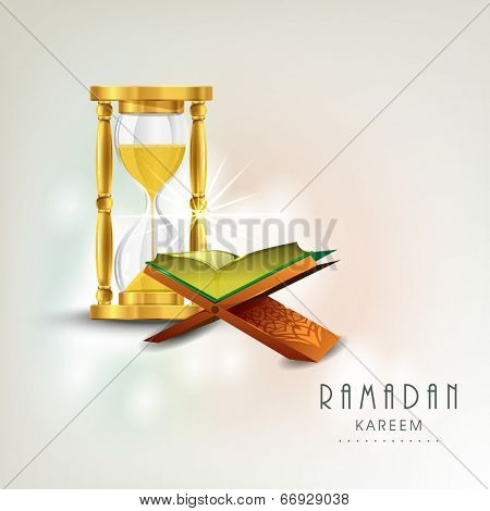 Open religious holy book Quran Shareef with golden sand watch on shiny colorful background for holy month of Muslim community Ramadan Kareem.