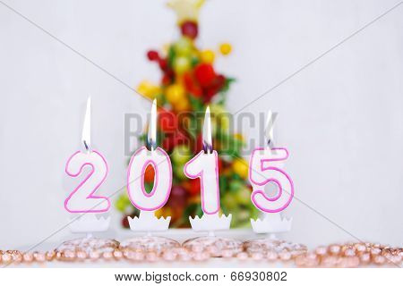 Burning Candles With 2015 Year And With Fruit Tree On Background.