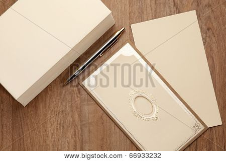 Invitation Card With Stack Of Envelop