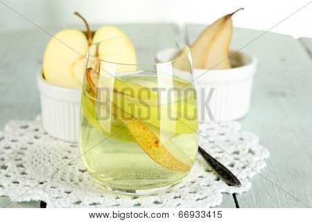 Sangria drink in glass on wooden table, on light background