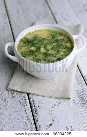 Delicious green soup with sorrel on table close-up