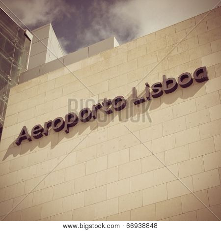 LISBON, PORTUGAL - MAY 26, 2014: The Lisbon airport sign in front of the main entrance of the Lisbon airport. In 2013, the Lisbon airport handled 16,024,955 passengers and 88,459 tonnes of cargo.