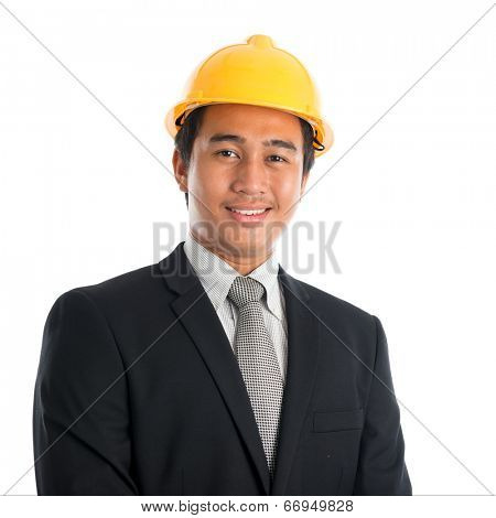 Close-up of an Asian young man wearing a hardhat smiling and looking at camera, standing isolated on white background.