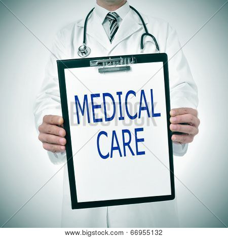 a doctor showing a clipboard with the text medical care written in it