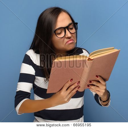 Geek student reading a book