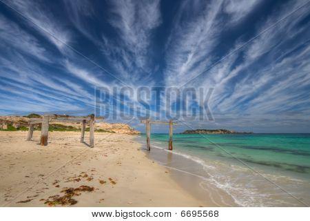 Ruins Of Pier Reaching Towards Sea