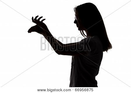 Silhouette of teenager girl making shadows play