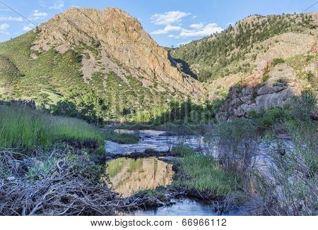 North Fork of Cache la Poudre River with springtime flow in Eagle Nest Open Space in northern Colorado at Livermore near Fort Collins