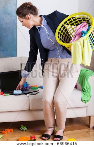 Young Businesswoman Doing The Housework