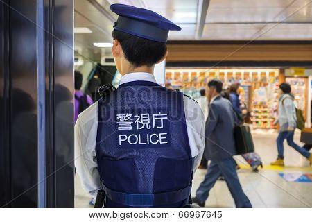 Japanese Police Man in Tokyo Station