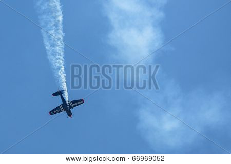 BERLIN, GERMANY - MAY 21, 2014: A Extra-300, D-EAXK- two-seat aerobatic plane (Germany), demonstration during the International Aerospace Exhibition ILA Berlin Air Show-2014.
