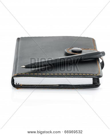 Black Leather Note Book And Pen On White