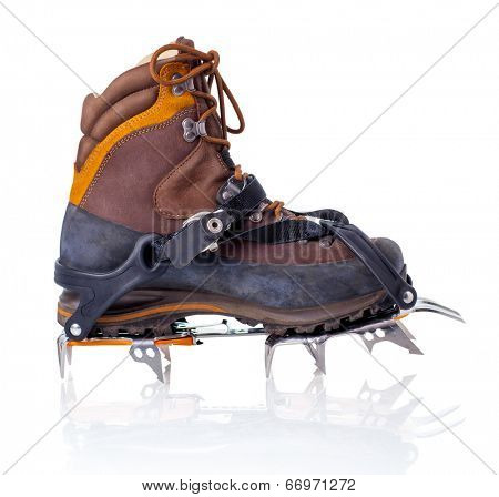 Boot with crampons isolated on white with reflection