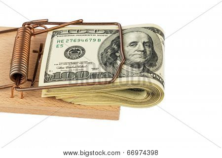 dollar banknotes in a mousetrap. symbolic photo for debt