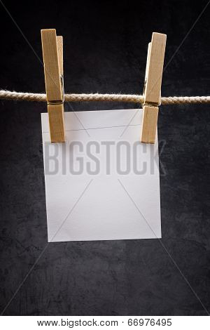 Blank Note Paper Hanging On Rope With Clothes Pins