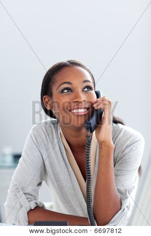 Smiling Young Businesswoman On Phone Looking Upward