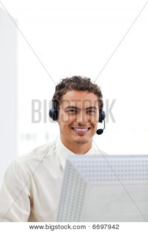 Smiling Businessman Working At A Computer