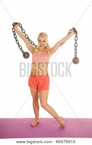 Blond Woman Orange Shorts Hold Up Ball And Chain