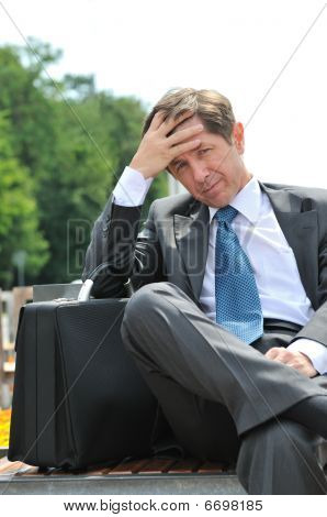 Depressed Senior Business Man Portrait