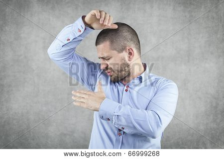 Businessman Smelling His Armpits