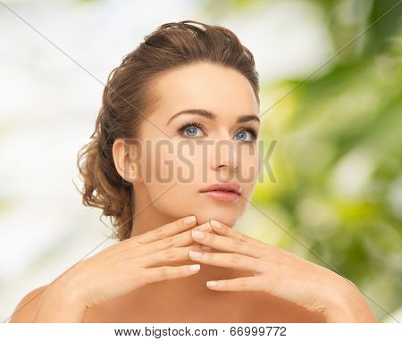 health and beauty concept - face and hands of beautiful woman with updo, can be used as a template for jewelry