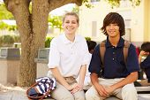 stock photo of playground school  - High School Students Wearing Uniforms On School Campus - JPG