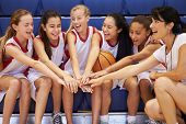stock photo of bench  - Coach Of Female High School Basketball Team Gives Team Talk - JPG