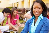 picture of playground school  - High School Teacher Sitting Outdoors With Students On Campus - JPG