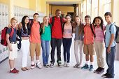 foto of 13 year old  - Group Of High School Students Standing In Corridor - JPG