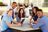 stock photo of 16 year old  - High School Students Working On Campus With Teacher - JPG