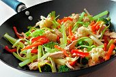 stock photo of fried chicken  - Stir fry with mixed vegetables and chicken in a wok - JPG