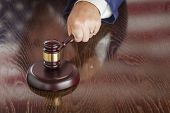 stock photo of slam  - Judge Slams His Gavel and American Flag Table Reflection - JPG