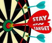 foto of stubborn  - Stay on Target words on a dart board to illustrate keeping your focus on the mission - JPG