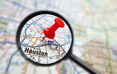 stock photo of texas map  - Closeup of a Houston Texas map with red pin and magnifying glass - JPG