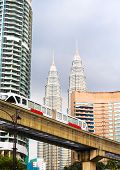 stock photo of petronas twin towers  - Cityscape with monorail and high office buildings in Kuala Lumpur Malaysia - JPG