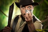 stock photo of machete  - Surprised young explorer finding a huge precious diamond in the jungle - JPG
