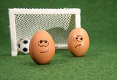 stock photo of envy  - funny eggs and football - JPG